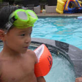 Aaden plays it safe in the pool with floaties and goggles.  Keep pract