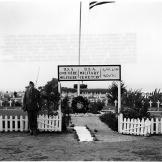 "Original caption: ""A Presidential wreath decorates an American ce"