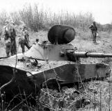 A Russian made PT76 tank destroyed at Ben Het, Vietnam 1968.  Watch video of the