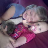 Ysabel and Truely snuggle with Kit Kat.
