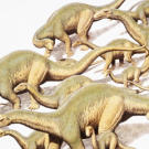 """Although it reached a length of around 90 feet (27 meters), Diplodocus was built much more lightly than its sauropod relatives, like Apatosaurus. The next giant's name means """"titanic lizard."""""""