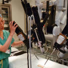 Outside of the classroom, robots can help doctors perform procedures on human patients. Registered nurse Haesook Lee adjusts a surgical robot at Beth Israel Medical Center in New York City. Surgical robots help doctors with everything from prostate removal to heart surgery.
