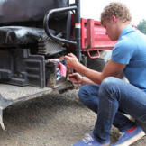 Jeremy Roloff, one of the twins, fixes a tractor.  As one of the oldes