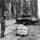 Cpl. Luther E. Boger of the 82nd Airborne Division reads a warning sign. The street leads to the Rhine River and was under observation of the Germans who occupied a stronghold there, April 1945. Watch video of the