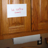 A few notecards around kitchen help the kids with their Spanish lesson