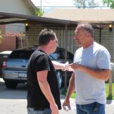 Turf infringement? Scott Menaged and Ed Rosenberg argue after bidding.