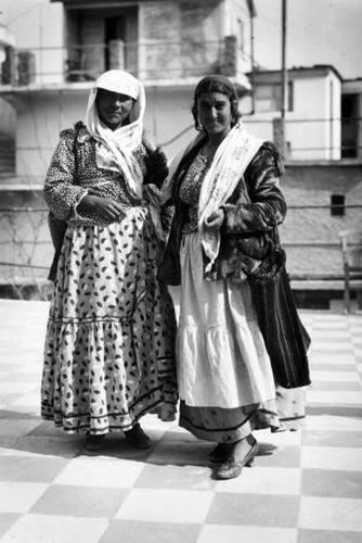Greek gypsies wear traditional clothing in this photo from 1930.