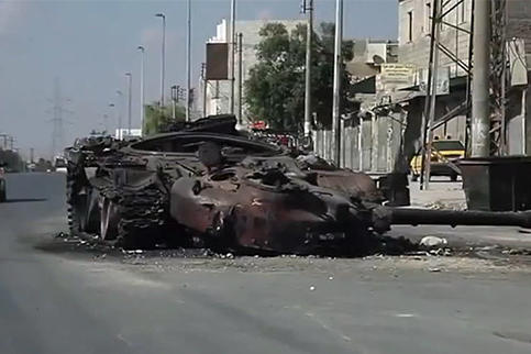A blown out tank in Aleppo during the Syrian civil war, October 6, 2012. Watch