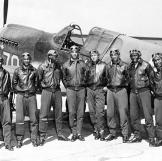 "A group of aviators from the famous Tuskegee 99th Fighter Squadron who distinguished themselves from bases in North Africa and Italy. Bomber crews were thankful to have the ""Red-Tail Angels"" escort them on dangerous missions into Germany and Central Europe."