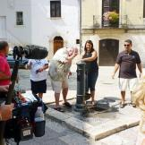 Mauro and the family take a minute to cool down at a drinking fountain
