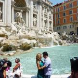 Lisa and Buddy share a romantic moment at the Trevi Fountain.