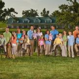 The entire Duggar family in front of their house.