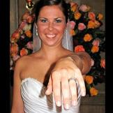 Chelsea shows off her wedding ring.