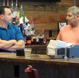 Bryan and Alan Tallis hunt for a bar in Dallas, Texas.