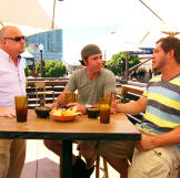 Tom Powers, Ben Levine and Lars Havens talk turkey in Tempe.