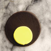 Place the 3-inch circle on the surface of the ganache-covered cupcake
