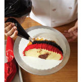 Continue to pipe the black ring around the entire diameter of the turkey cake.