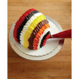Cover every bare inch of cake with a colored ring. Be sure to end in the front with a white ring of buttercream.