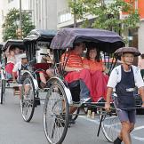 Jim Bob and Michelle lead the way via rickshaw.