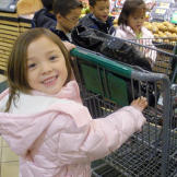 Alexis is excited to drive the cart.