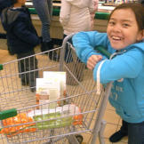 Mady all smiles while shopping for ingredients for the family's Hodge