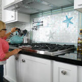 Jen gets ready to make some hot water on a stovetop that she can reach!