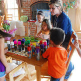 The Gosselin's babysitter, Ashley, instructs the kids on the fun activ