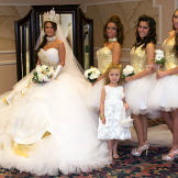 Nettie and her bridesmaids sparkle in gold and crystals.