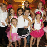 These gypsy kids are dressed to the nines for a party!