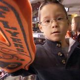 Aaden Gosselin wears an oversized Flyers #1 hand.