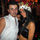 Priscilla poses with birthday boy Tommy at his gypsy royalty-themed party.