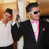 Pete and his groomsman make sure their hair is perfect before the wedding.