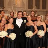 John cozies up to Stephanie's bridesmaids.