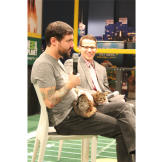 Lil Bub and her dude, Mike Bridavsky, answer questions at The Puppy Bowl Experience in Times Square.