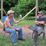 Tim shows off a jar of moonshiner to Tickle.