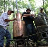 Jeff, Jim Tom and Mark fix a still out in the woods.