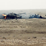 Still burning, these two Iraqi T-55 main battle tanks were damaged by