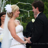 """Holly and her groom, Robert, exchange vows during the ceremony. """""""