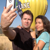 Justin and Evelin take a selfie during her birthday hot air balloon ri