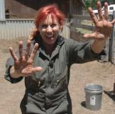 This is what Kari looks like when she gets pig poop on her hands.
