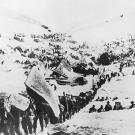 A line of prospectors begin their ascent toward the Chilkoot Pass that