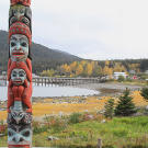 A Tlingit totem standing on the outskirts of Haines, Alaska symbolizes