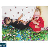"""So, one day while she was rocking Beau before his daily nap, Theo climbed up and joined. As she wrote in her blog, """"I was practically howling at the cuteness-and nearly woke them both up."""""""