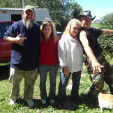 Turtleman (Ernie Brown, Jr.) and Neal James pose with cat owner Sue Cr
