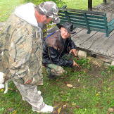 Ernie Brown, Jr., the Turtleman, and Neal James scout the perimeter of