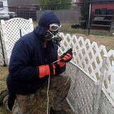 Turtleman prepares to catch the critter in homeowner Linda Jangula's b