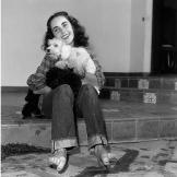 British-born actor Elizabeth Taylor, wearing a plaid shirt and jeans r