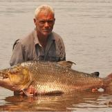 Jeremy Wade with a goliath tigerfish, a giant-sized relative of the pi