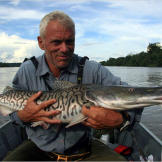 Jeremy Wade with a surubim catfish. This fish has an unusual duck-billed snout and can grow to 4 feet in length.