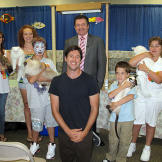 John with kids, cats and Cat Fancy Association President Jerry Hamza.